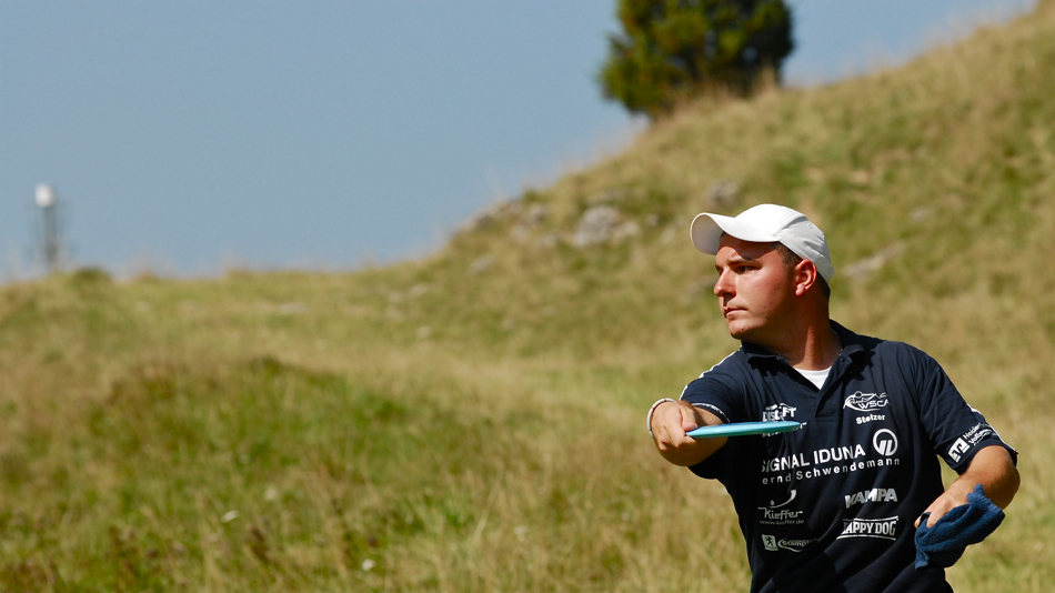 Michael Stelzer (Germany) slowly pulls his driver uphill to the pin. Europeans 2008.