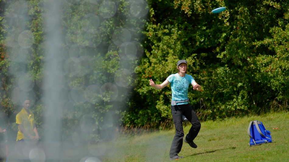Irmgard Derschmidt (Austria) mixes dancing and disc golf in this approach shot.