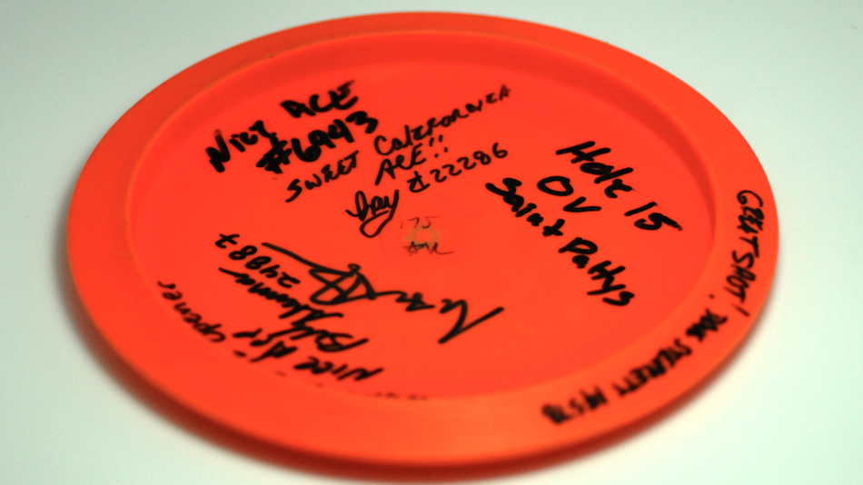 The photographer can also throw a disc. Hole in one at the PDGA Super Tour in Orangevale, California.